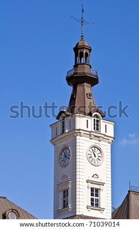 Image of a clock tower under clear blue sky.