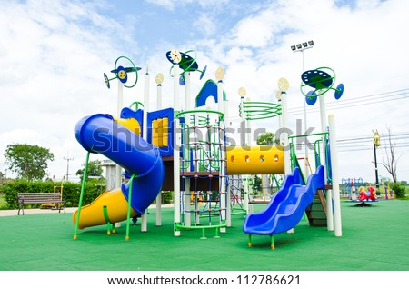 Image of a colorful children's playground in suburban area.