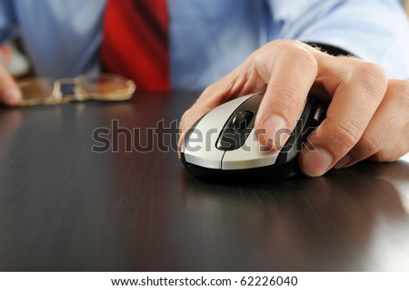 Image of a computer mouse in hand businessman