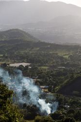 image of a controlled brush fire in the caribbean mountain town of Ocoa, dominican republic.