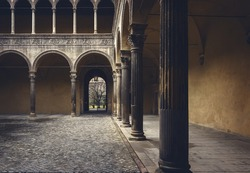 Image of a courtyard in the city of Bologna, Italy.