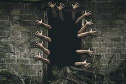 Image of a creepy hands emerging from the open haunted house door. Ghost hands.