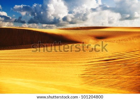 Image of a desert under cloudy sky. Soft focus filter