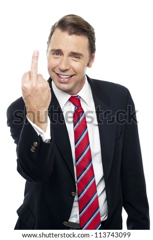 Image of a displeased businessman showing middle finger politely. Isolated against white