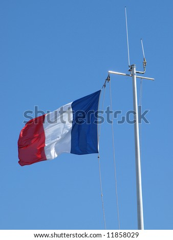 image of a french flag in a blue sky