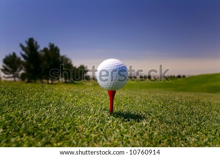 Image of a golf ball on red tee in Vegas