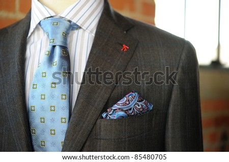 Image of a Gray Suit with Blue pin striping and boutonniere
