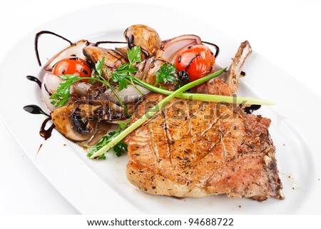 image of a  grilled steak with vegetables on a white plate