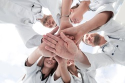 image of a group of diverse medical staff showing their unity.