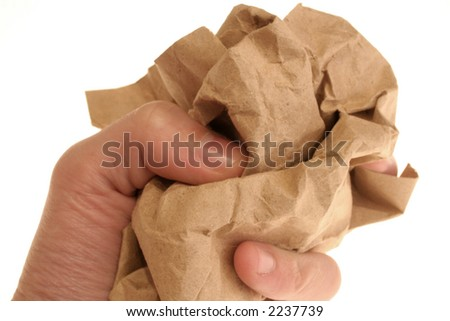 image of a hand squeezing crumpled paper