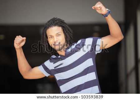Image of a happy man flexing his arm muscles