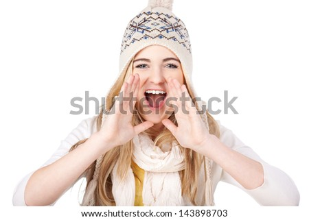 Image of a happy teenage girl shouting wearing warm clothes, isolated on white background.