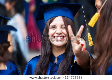 Image of a happy young graduate - outdoor shot