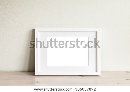 Image of a horizontal white frame mockup.