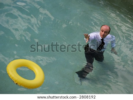 Image of a life saving ring being thrown to a business man.