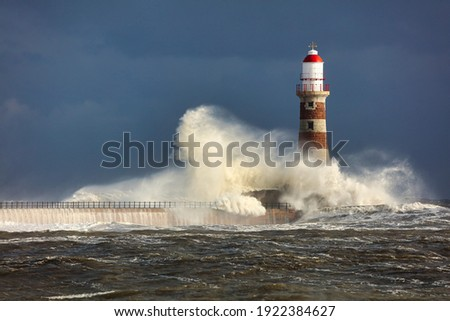 Image of a Lighthouse during a storm at Sunderland, Tyne and Wear, England, UK.