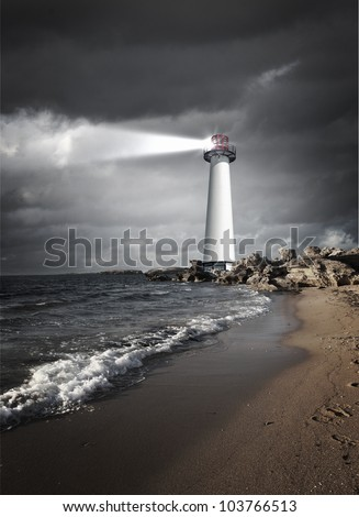 Image of a lighthouse with a strong beam of light