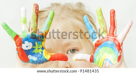 image of a little girl with hands painted. See my portfolio for more