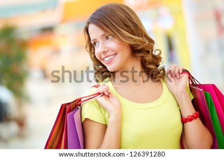Photo of Image of a lovely shopping lady holding her purchases