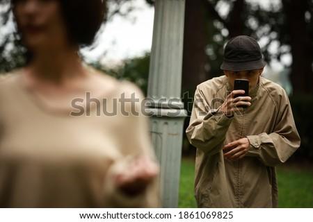 Image of a man voyeuring a woman Сток-фото ©