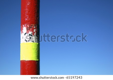 Image of a marker indicative of danger, red and yellow