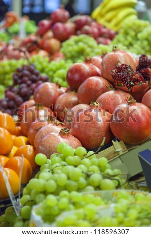 Image of a market stall with fresh fruit and vegetables.