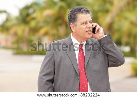 Image of a mature businessman on the phone