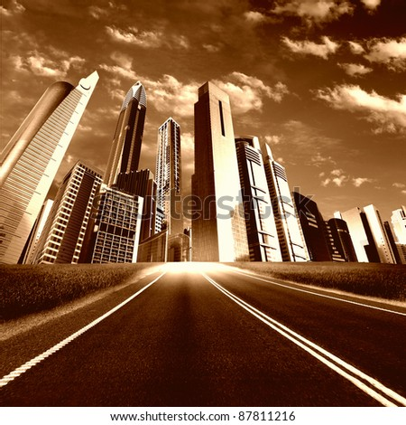 Image of a modern city and road  leading to it - stock photo