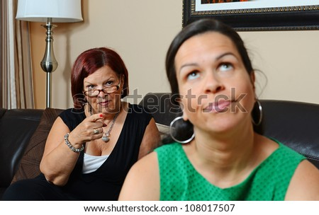 Image of a mother looking upset at her daughter