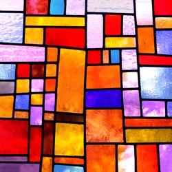 Image of a multicolored stained glass window with irregular block pattern , square format