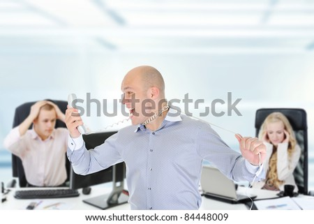 image of a nervous businessman screaming on the phone.