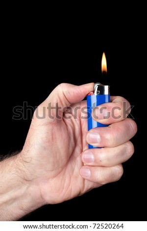 Image of a person lighting a blue portable butane lighter against a dark background.  Image good for smoking, mechanical or dexterity inferences.