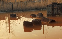 Image of a pond with very toxic industrial drosses. Location: Copsa Mica,Romania, a town which in 1990 was known as one of the most polluted places in Europe.