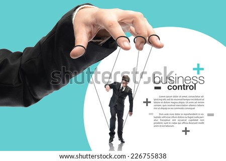 image of a puppet businessman standing on against each other, concept of business control