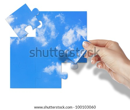Image of a puzzle with blue sky and white clouds