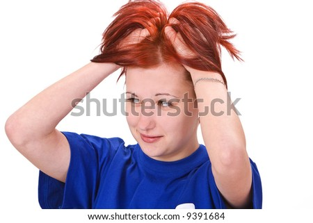 Image of a redheaded girl expressing a reaction to an unexpected mistake.