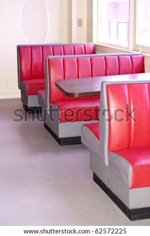 Image of a Retro Diner with Empty Red Booths and Tables