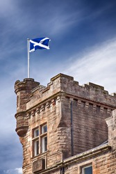 Image of a scottish flag flying on a building in the town of Callander, Scotland.