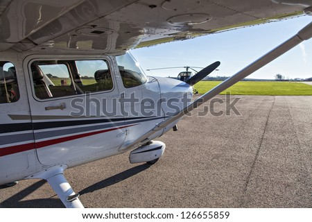 Image of a small private airplane waiting for take off