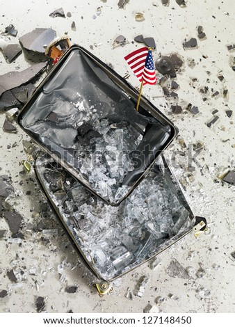 Image of a smashed television and USA flag