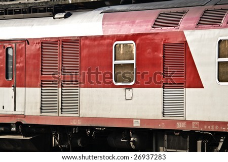 Image of a train passing through a station - stock photo