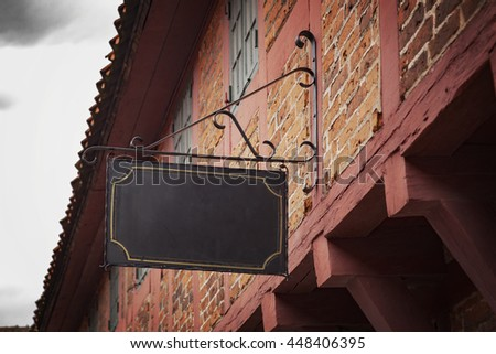 Image of a vntage sign on an old building.
