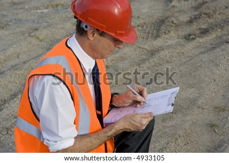 Image of a white collar worker on a new building site