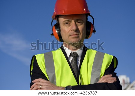 Image of a white collar worker wearing safety equipment.