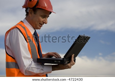 Image of a white collar worker with safety gear.