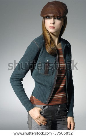 Image of a woman in cap on gray  background