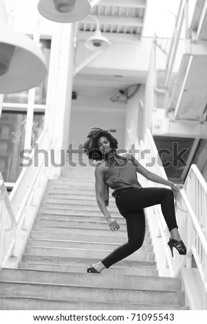 Image of a woman posing on a staircase