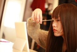 Image of a woman who cuts her bangs by herself