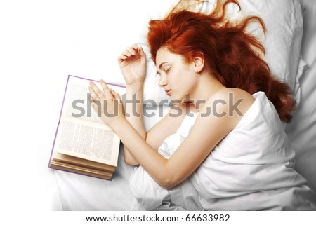 Image of a woman who reads a book in bed