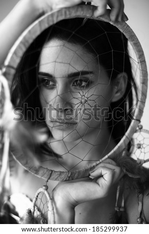 image of a woman with a dream catcher , girl in traditional Indian wear and dream catcher posing to the camera ,